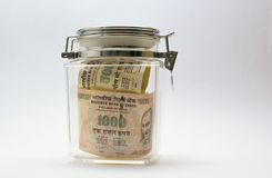 Indian Money or Rupee or currency or bank notes in glass jar Royalty Free Stock Image