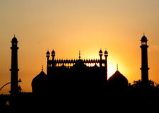 Indian Mosque Silhouette at Sunset Stock Photo