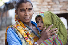 Indian mother and baby. Chanderi, India - January 4, 2015: Indian mother and baby with traditional bindi and kohl around baby's eyes. Kohl is applied around Stock Photos