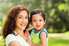 Indian mother baby. Portrait of happy young indian mother and baby boy outdoors Stock Image