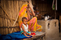 Indian mother and child in tea shop. Indian mother and child sitting in tea shop of village stock photography