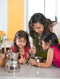 Indian mother cooking Stock Photo