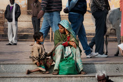 Indian mother and son talking on the street at the temple Royalty Free Stock Photos