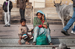Indian mother and son talking on the street at the temple Stock Photos