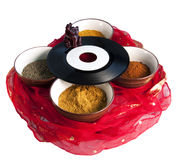 Indian music. An old 45 rpm record on four cups full of Indian spices Stock Photo