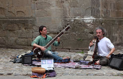 Indian music. Carcassonne, France, July 17th 2011:Two men playing traditional Indian instrumets in the streets of the Fortified town of Carcassonne in France.The Stock Photography