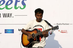 Indian musician play guitar during happy streets program Royalty Free Stock Image