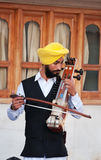 Indian musician playing sarangi in Golden Temple in Amritsar. India Royalty Free Stock Photography