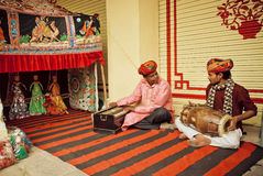 Indian musicians playing traditional songs on puppetry performance with toys. JAIPUR, INDIA - JAN 24: Indian musicians playing traditional songs on puppetry Stock Photo