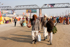 Indian musicians walking on the street Royalty Free Stock Photo