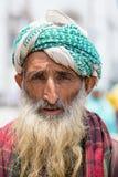Indian muslim man in the street market in Srinagar, Kashmir. India Royalty Free Stock Photography