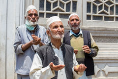 Indian muslim men begging on the streets near the mosque in Srinagar, Kashmir. India Stock Images