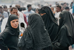 Indian Muslim women. A group of Indian Muslim women in burqua are talking on the street. Among the Muslim population in India, the burqa is common in many areas Royalty Free Stock Images