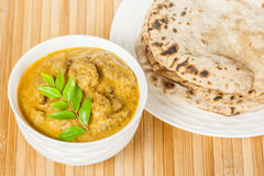 Indian Mutton Curry and Chapati. Closeup view of delicious Indian mutton curry served with fluffy homemade chapati (indian bread). The curry is prepared using Stock Photo