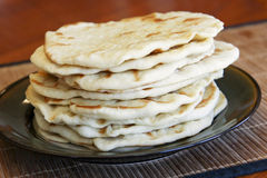 Indian Naan Bread. Stack of Indian naan bread on a plate Royalty Free Stock Photography