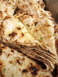 Indian Naan Bread. Closeup of a stack of Indian naan bread in an Indian cuisine Stock Images