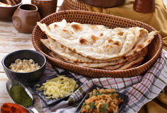 Indian naan bread with some ingredients of indian food Stock Photography