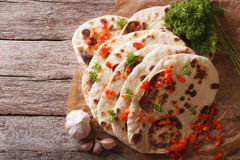 Indian Naan flat bread with garlic and herbs. horizontal top vie Stock Photos