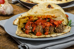 Indian naan with meatballs and tomato sauce Royalty Free Stock Images