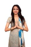 Indian in a namaste pose. Young Indian in a namaste(greeting) pose stock images