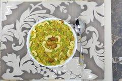 INDIAN NAMKEEN KAJU RAISIN MIXTURE. Indian namkeen snacks lahsun gathiya spices crunchy white bowl background flavour fried oil royalty free stock photo