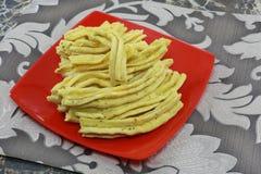 INDIAN NAMKEEN SNACKS GATHIYA BESAN. Indian namkeen snacks lahsun gathiya spices crunchy white bowl background flavour fried oil royalty free stock images