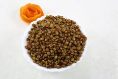 INDIAN NAMKEEN TEEKHA MIXTURE SNACKS. Indian namkeen snacks lahsun gathiya spices crunchy white bowl background flavour fried oil stock images
