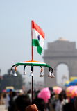 Indian National Flag. Mini Indian National Flag against backdrop of India Gate, New Delhi, India stock image