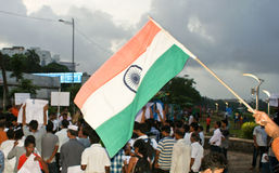 Indian national flag waved during protest rally. Indian national flag called tricolor being waved during a protest rally held recently in Mumbai on 20th August Stock Photography