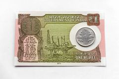 Indian New One Rupee Note & Coin stock photography