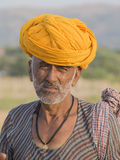 Indian nomad attended the annual Pushkar Camel Mela. PUSHKAR, INDIA - OCTOBER 28, 2014: Unidentified Indian man attended the annual Pushkar Camel Mela. This fair Royalty Free Stock Photography