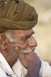 Indian nomad attended the annual Pushkar Camel Mela. PUSHKAR, INDIA - OCTOBER 27, 2014: Unidentified Indian man attended the annual Pushkar Camel Mela. This fair Royalty Free Stock Photo