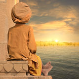 Indian oasis. Hindu man meditating in a indian oasis Royalty Free Stock Images
