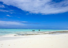 Indian ocean beach of Zanzibar. 2 boats Stock Photo