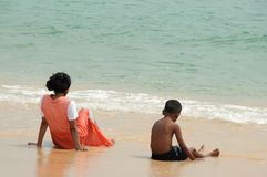 On the Indian ocean. Children on the shore of the Indian Ocean Royalty Free Stock Images