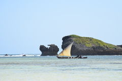 Indian ocean dhow passing rocks. Traditional sailing dhow passing rocks in Indian ocean, Watamu, Kenya stock photos