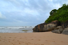 Indian ocean with golden sand, Bentota, Sri Lanka. A wonderful nature landscape of a beach scene. Stock Photo