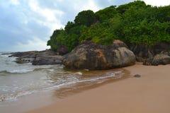 Indian ocean with golden sand, Bentota, Sri Lanka. A wonderful nature landscape of a beach scene. Royalty Free Stock Photography