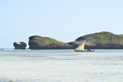 Indian ocean image dhow sailing past rocks Royalty Free Stock Photography