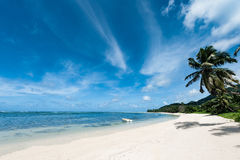 Indian Ocean Low Tide in Seychelles, Mahe Island. Palm tree shadow on the beach sand Royalty Free Stock Image