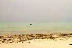 Indian Ocean peaceful seascape in Zanzibar Unguja. Landscape with sparkling blue water off the white beaches of the Indian Ocean spice island of Zanzibar Unguja Stock Photos