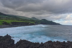 Indian Ocean under grey clouds. Clouds over the Reunion island Stock Image