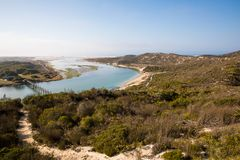 Indian Ocean view in the De Mond coastal nature reserve, South Africa. Nature path with bridge and river in the De Mond coastal nature reserve, South Africa stock photography