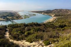 Indian Ocean view in the De Mond coastal nature reserve, South Africa. Nature path with bridge and river in the De Mond coastal nature reserve, South Africa royalty free stock image