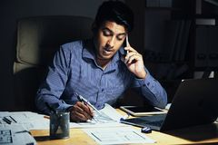 Man working in office at night royalty free stock photo
