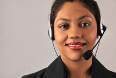 Indian operator. Beautiful operator smiling, with copy space on left Stock Photos