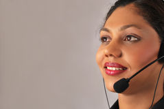 Indian operator. Beautiful indian operator smiling, with a  headset Stock Image