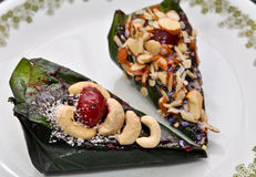 Indian Paan. Paan, is an Indian, Pakistani and Southeast Asian traditionof chewing betel leaf (Piper betle) with areca nut and slaked lime paste, and katha (or Stock Photography