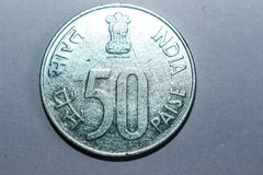 Indian 50 paise silver colour coin. Indian paisa silver colour  money currency bank finance vintage antique collection numismatic cash banking sell flow note royalty free stock image