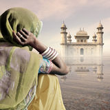 Indian palace in the mist. Woman near a indian palace in the mist Royalty Free Stock Photography